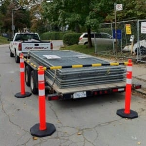 Delineator posts around trailer