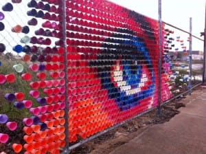 Colored cups on chain link fence