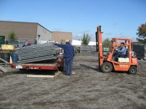 Loading temporary fence panels