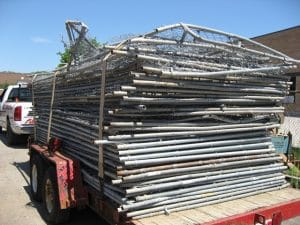Damaged temporary construction fence rentals