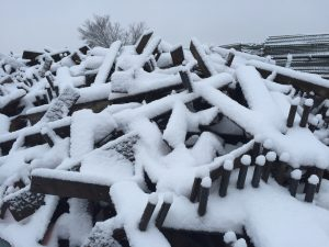 Temporary fence ground stands covered in snow
